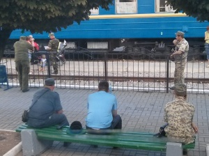 Russian miltary harassing a mother at the train checkpoint